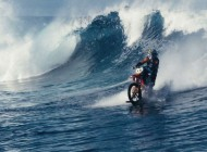 Watch: Crazy Dude Rides the Waves On A Dirt Bike