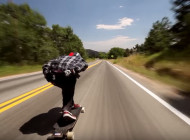 Watch: This Crazy Dude Rides a Longboard Down a Highway at 70 MPH
